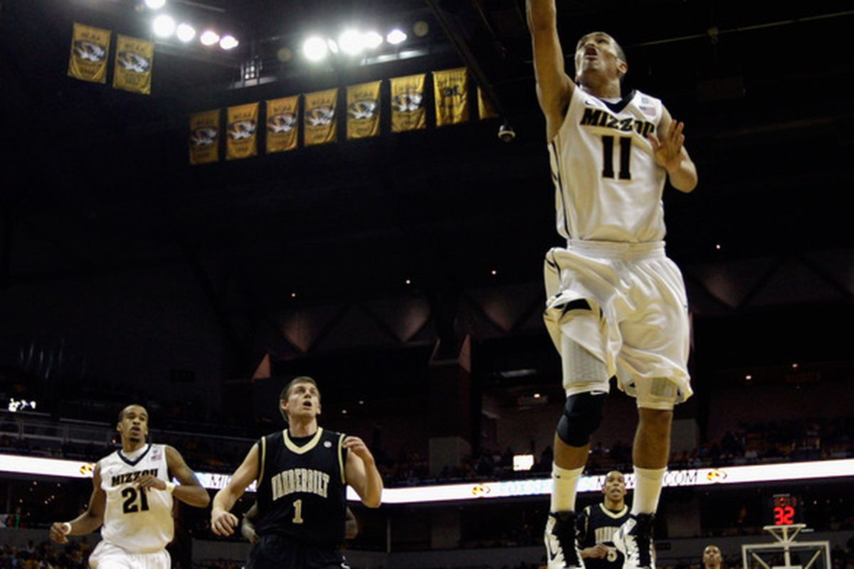COLUMBIA MO - DECEMBER 08:  Michael Dixon #11 #10 of the Missouri Tigers goes in for a lay-up during the game against of the Vanderbilt Commodores on December 8 2010 at Mizzou Arena in Columbia Missouri.  (Photo by Jamie Squire/Getty Images)