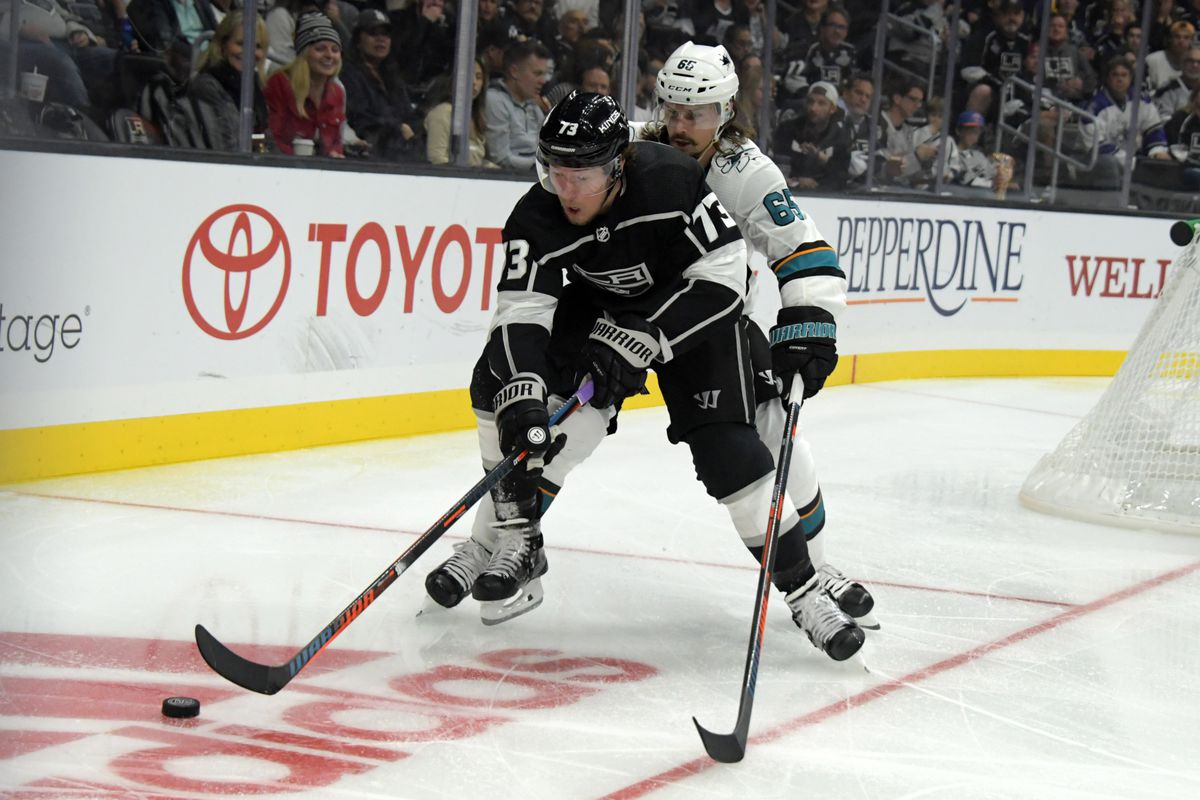 Oct 5, 2018; Los Angeles, CA, USA; Los Angeles Kings right wing Tyler Toffoli (73) and San Jose Sharks defenseman Erik Karlsson (65) battle for the puck in the second period at Staples Center.