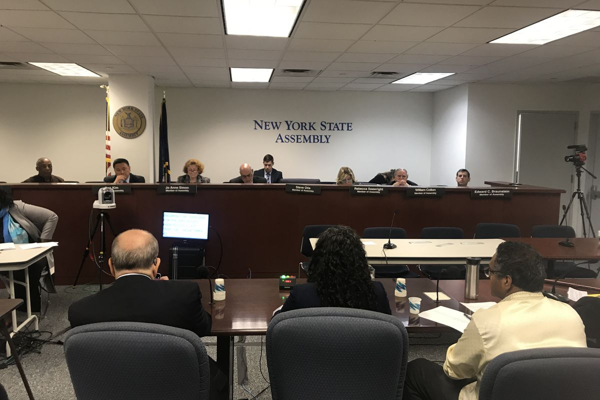 The New York Assembly's education committee hears testimony in the city over admissions to specialized high schools.