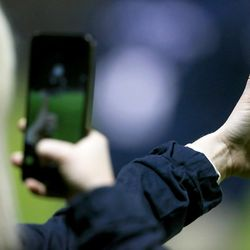 A BYU student takes a photo of her thumb after the win as BYU defeats UNLV 2-0 in the first round of the NCAA tournament in Provo on Friday, Nov. 11, 2016.