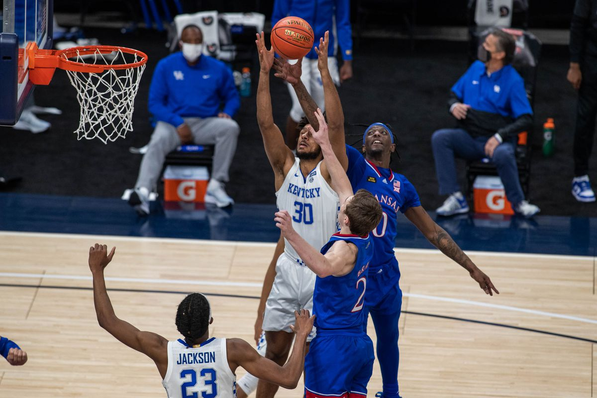 Kentucky Wildcats forward Olivier Sarr fights for the rebound over Kansas Jayhawks guard Christian Braun and guard Marcus Garrett in the second half at Bankers Life Fieldhouse.