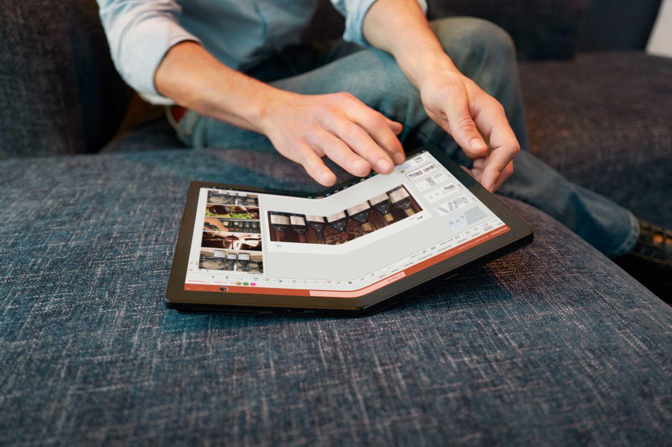 A user uses the ThinkPad X1 fold.