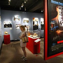 """Betsy Shindler looks at a display in the Lancaster Cultural History Museum of the film """"Witness,"""" where romance blossoms between an Amish widow and a Philadelphia police officer investigating a murder."""