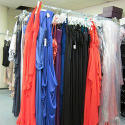 New dresses waiting to be hemmed to three different hem lengths
