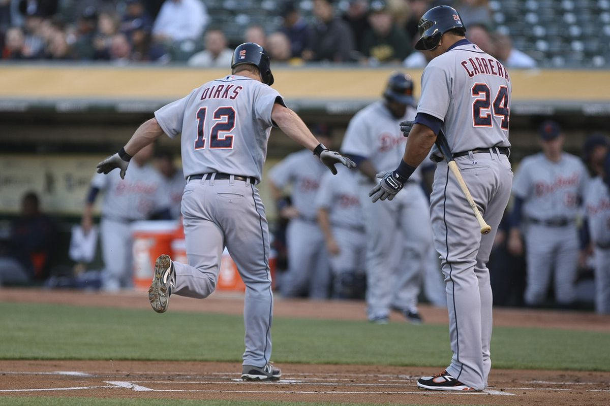 May 10, 2012; Oakland, CA, USA; Detroit Tigers left fielder Andy Dirks (12) runs in after hitting a home run against the Oakland Athletics during the first inning at O.co Coliseum. Mandatory Credit: Kelley L Cox-US PRESSWIRE