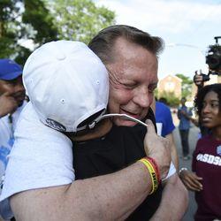 Father Michael Louis Pfleger hugs Parkland student activist Emma Gonzalez. | AP Photo/Annie Rice