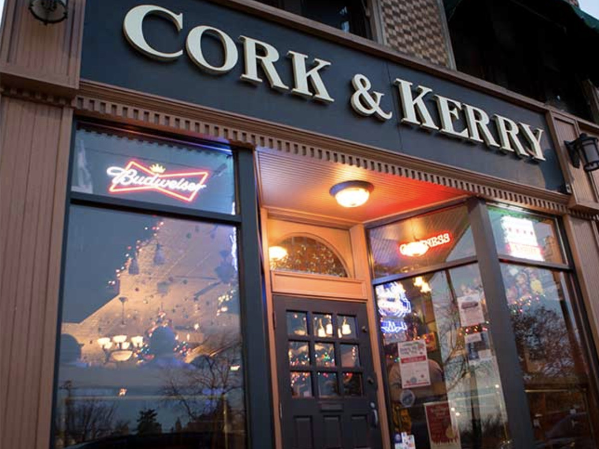 """A brick building with a large sign that reads """"Cork & Kerry."""""""