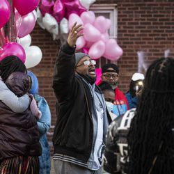 Johnny Adams, grandfather of 7-year-old Jaslyn Adams, leads a prayer as dozens of family members and supporters gather for a vigil outside the girl's grandmother's West Side home, Wednesday evening, April 21, 2021. Jaslyn was fatally shot Sunday, April 18, while in line at a McDonald's drive-thru with her father, who suffered one gunshot wound to the back and survived.