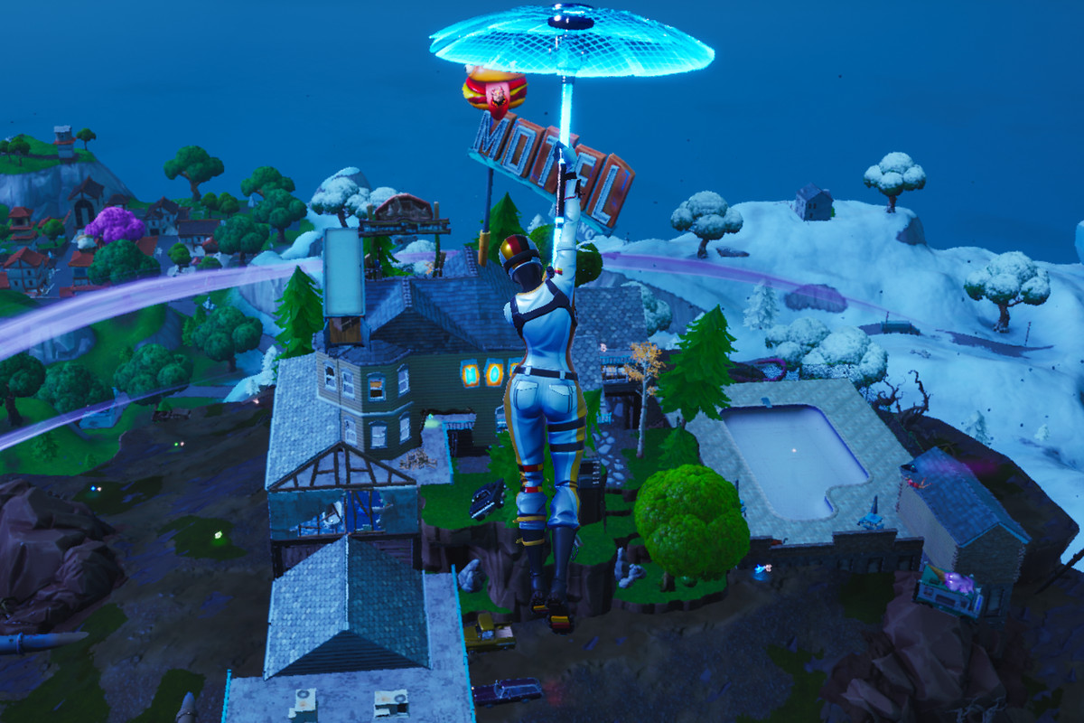 A Fortnite player gliding toward the floating island and the new Motel on top of it.