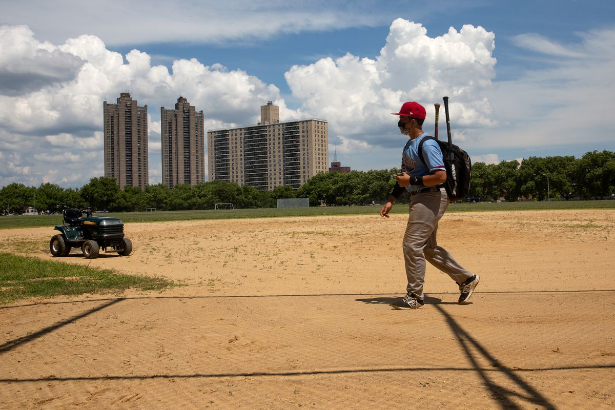 A little leaguer heads to practice in Bedford Park, Bronx, July 13, 2020.