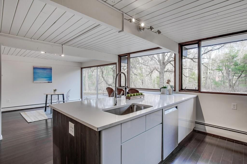 An open, sparse kitchen with a large island.