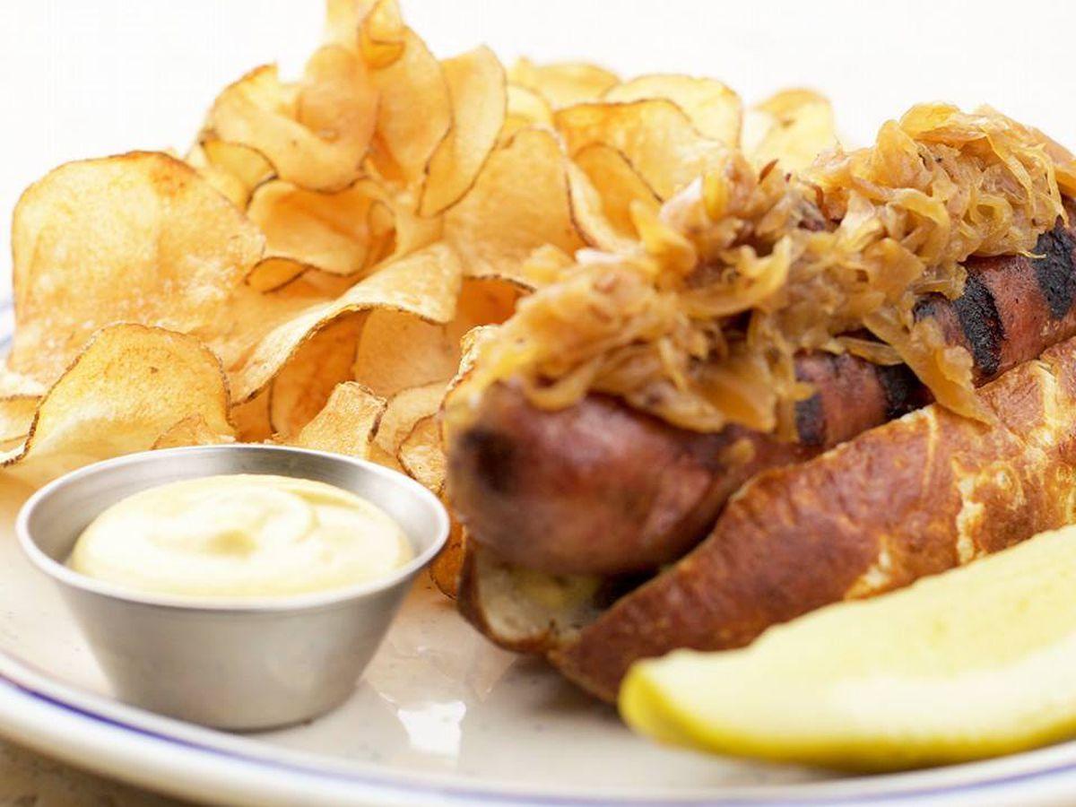 Sausage on pretzel bun at Roofers Union
