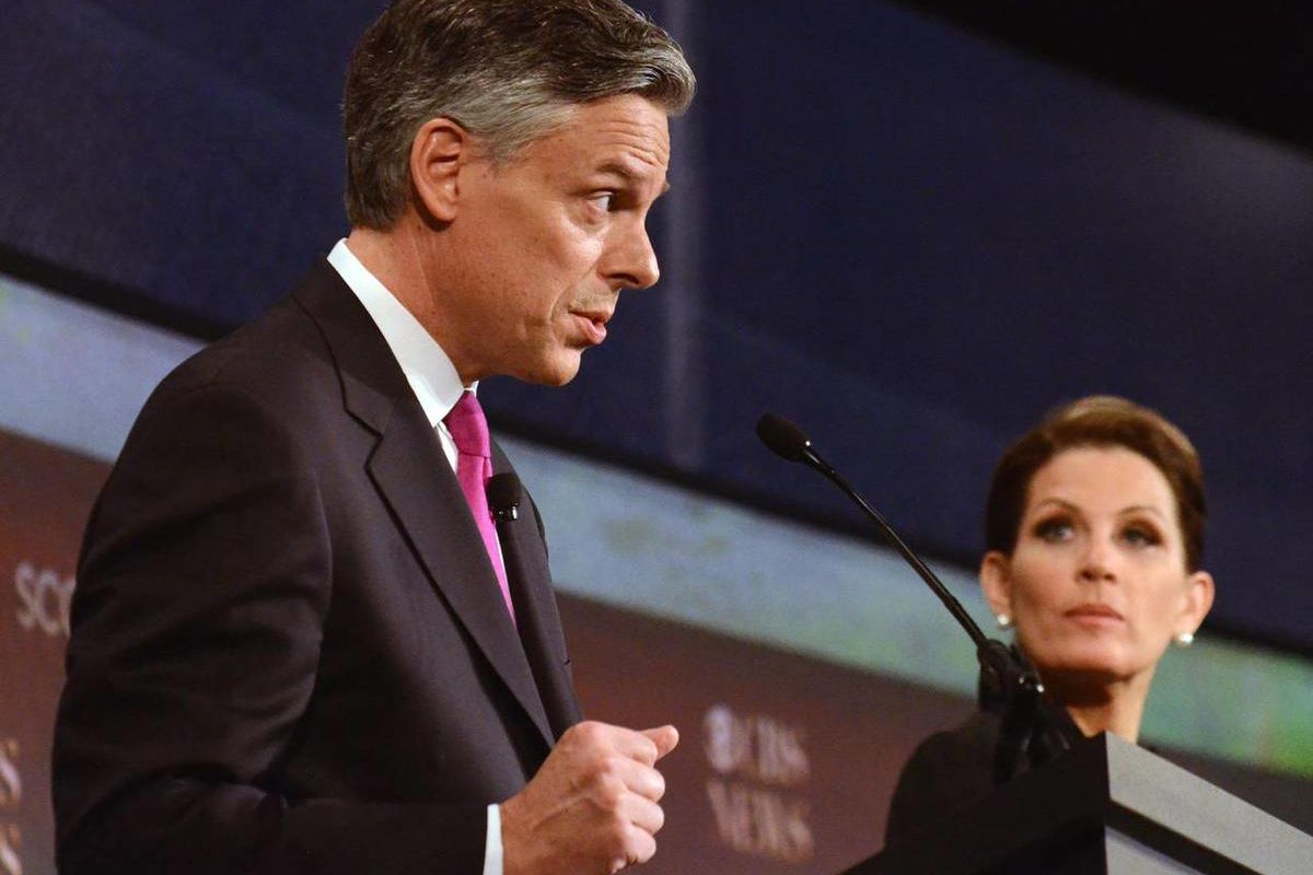 Republican presidential candidates Jon Huntsman, left, speaks as Michele Bachmann, looks on during the the CBS News/National Journal foreign policy debate at the Benjamin Johnson Arena, Saturday, Nov. 12, 2011 in Spartanburg, S.C.