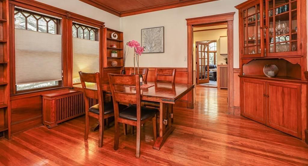 A woodsy dining room with a built-in hutch.