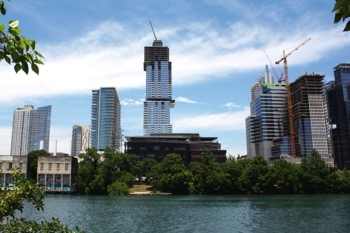 Medium shot of a skyline with tallest building, still under construction, standing out