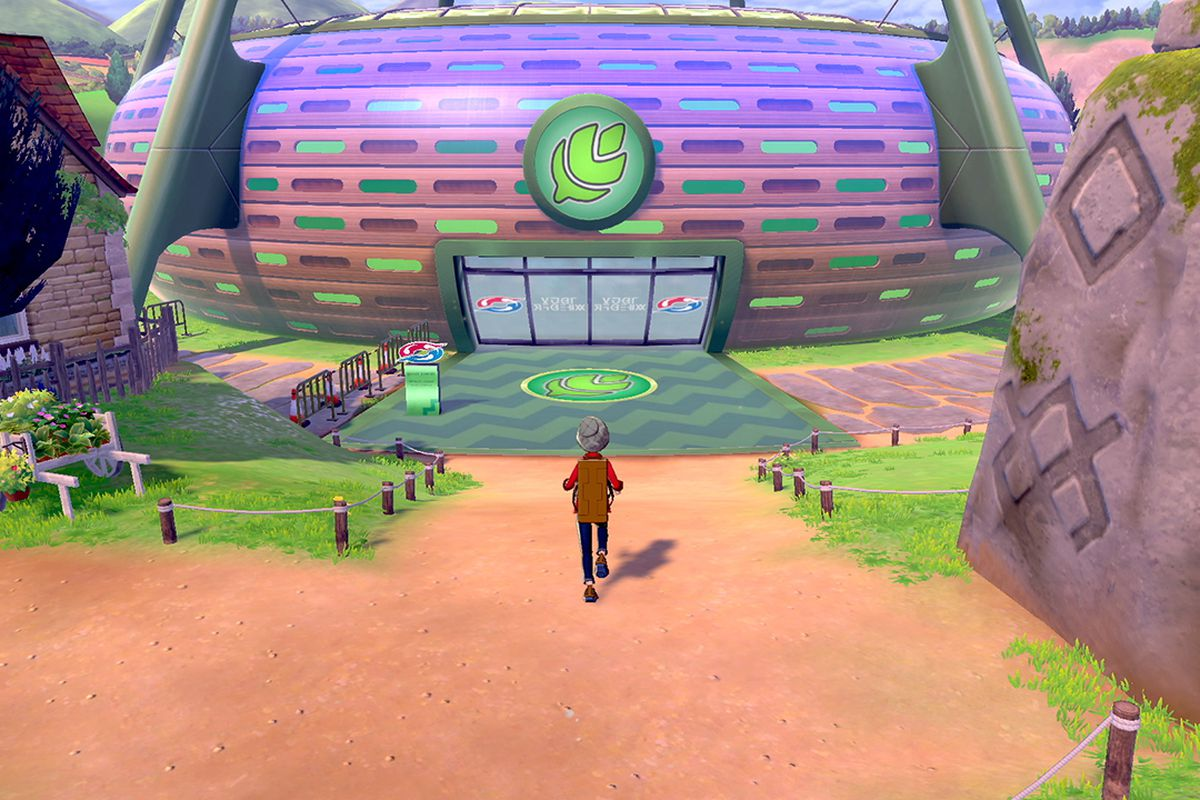 A Pokemon trainer walking into the grass arena
