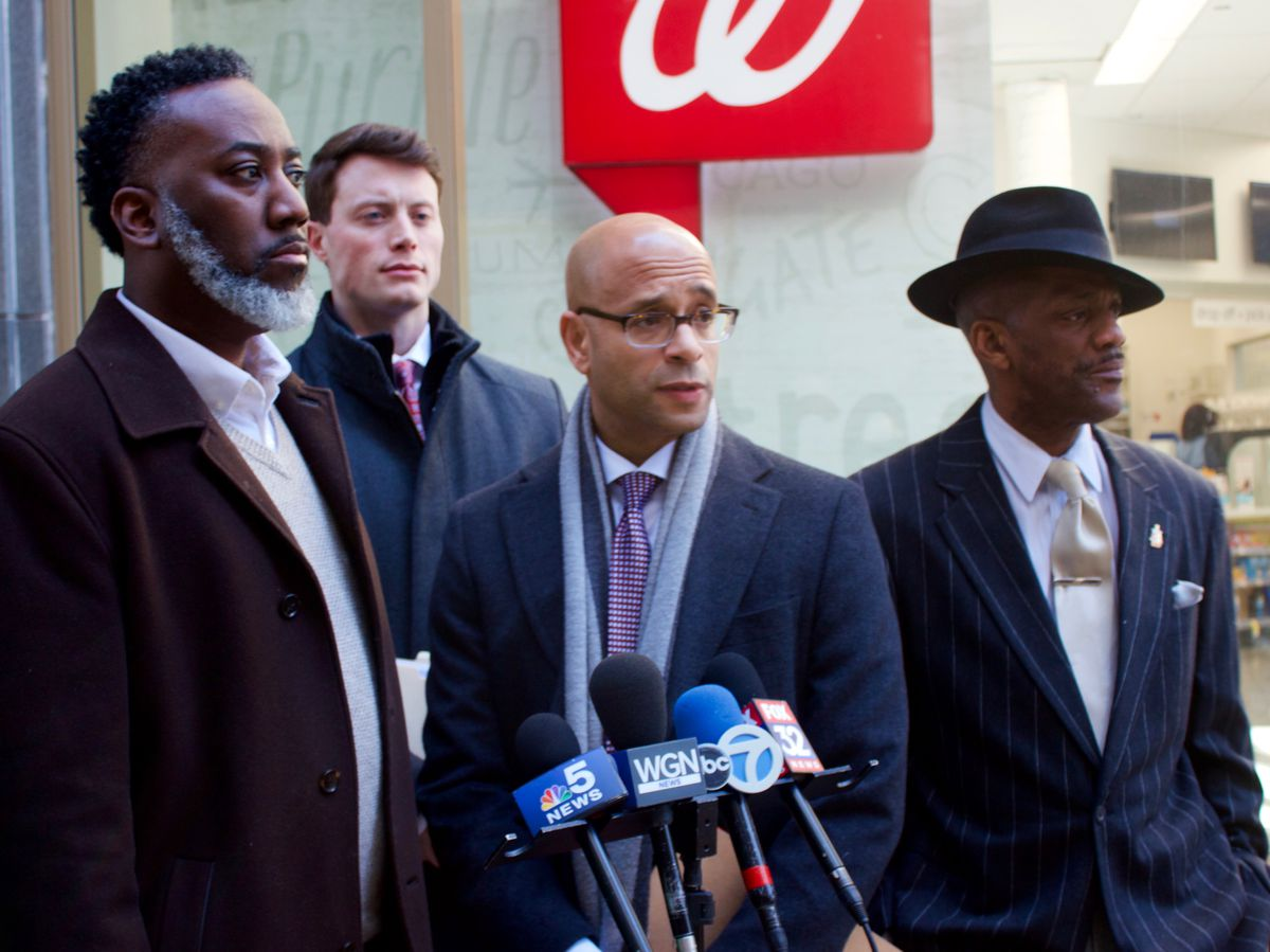Laurentio Howard (left), the father of a 16-year-old girl who was shocked with a Taser during a confrontation with police officers last month at her West Side school, attorney Andrew M. Stroth and Tree of Life Justice League Executive Director Eric Russel