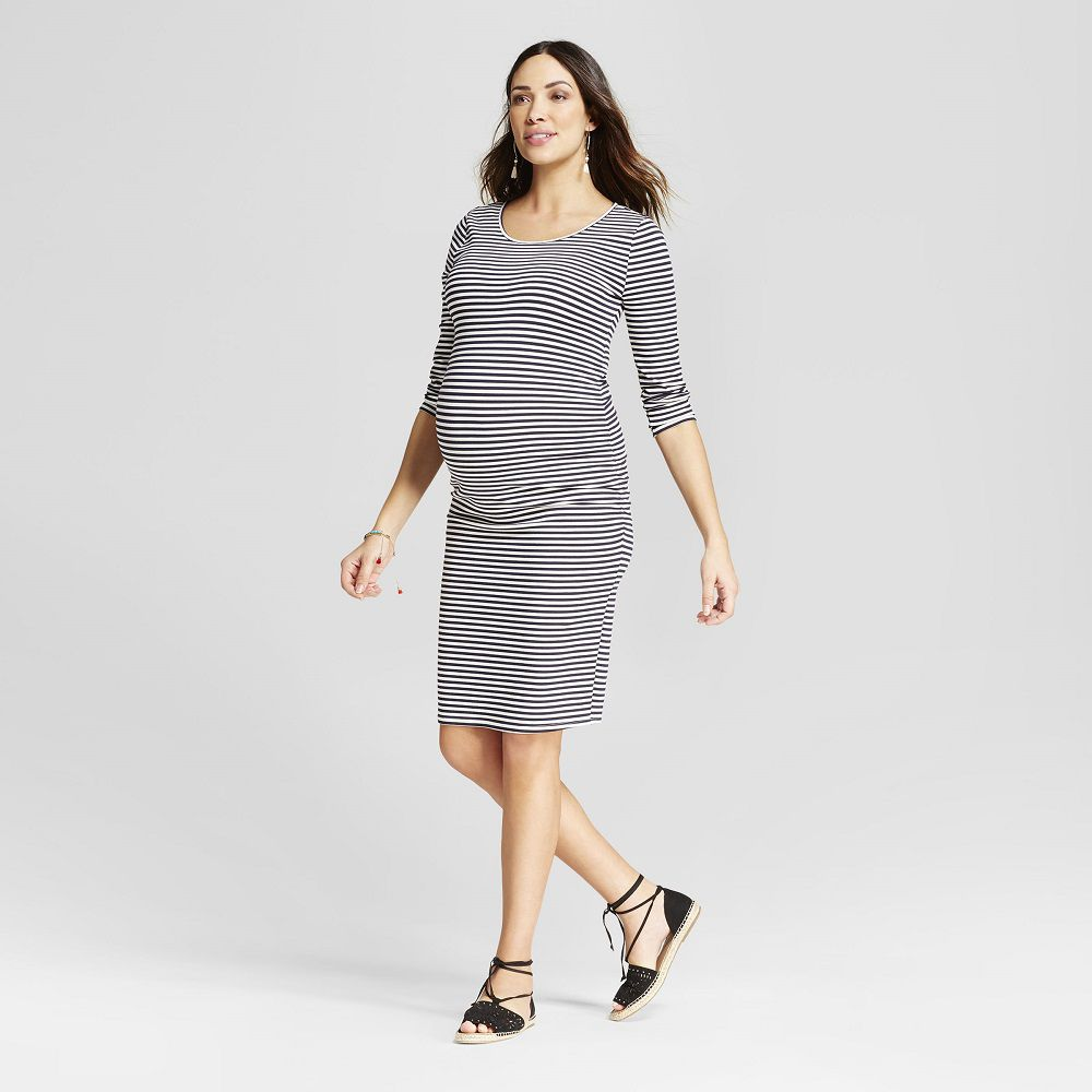 A pregnant woman in a striped dress