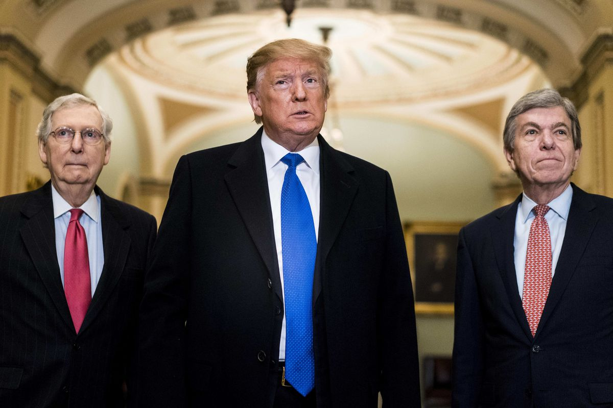 President Trump speaks to journalists, accompanied by Senator Mitch McConnell and Senator Roy Blunt.