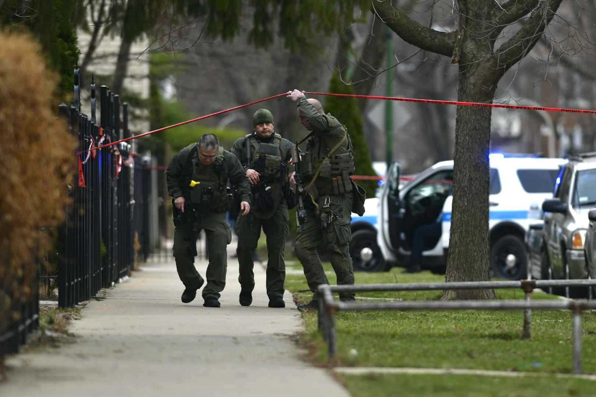 Police investigate after an officer was shot in the shoulder Thursday in Brighton Park — according to police by a shoplifter at a Home Depot who also wounded a security guard before being killed in a shootout with the police. The officer was the fourth Chicago cop to be shot in two weeks.
