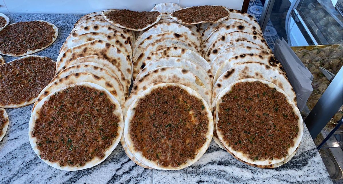 rows of round flatbreads topped with minced beef
