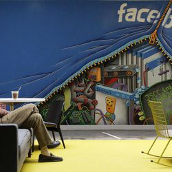 FILE-In this Friday, May 11, 2012, file photo, a worker sits in the Facebook office in Menlo Park, Calif.  Silicon Valley, it turns out, doesn't revolve around the stock prices of Facebook and its playful sidekick, Zynga. Instead, the optimism in Silicon Valley can be seen in a variety of ways in this area that covers roughly 40 miles from San Jose to San Francisco.