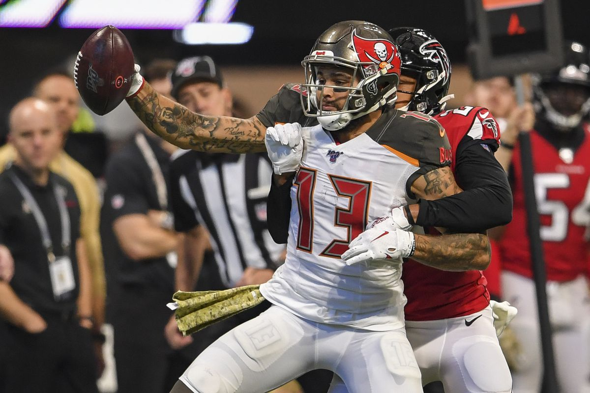 Tampa Bay Buccaneers wide receiver Mike Evans reaches for yardage against Atlanta Falcons cornerback Isaiah Oliver during the first half at Mercedes-Benz Stadium.