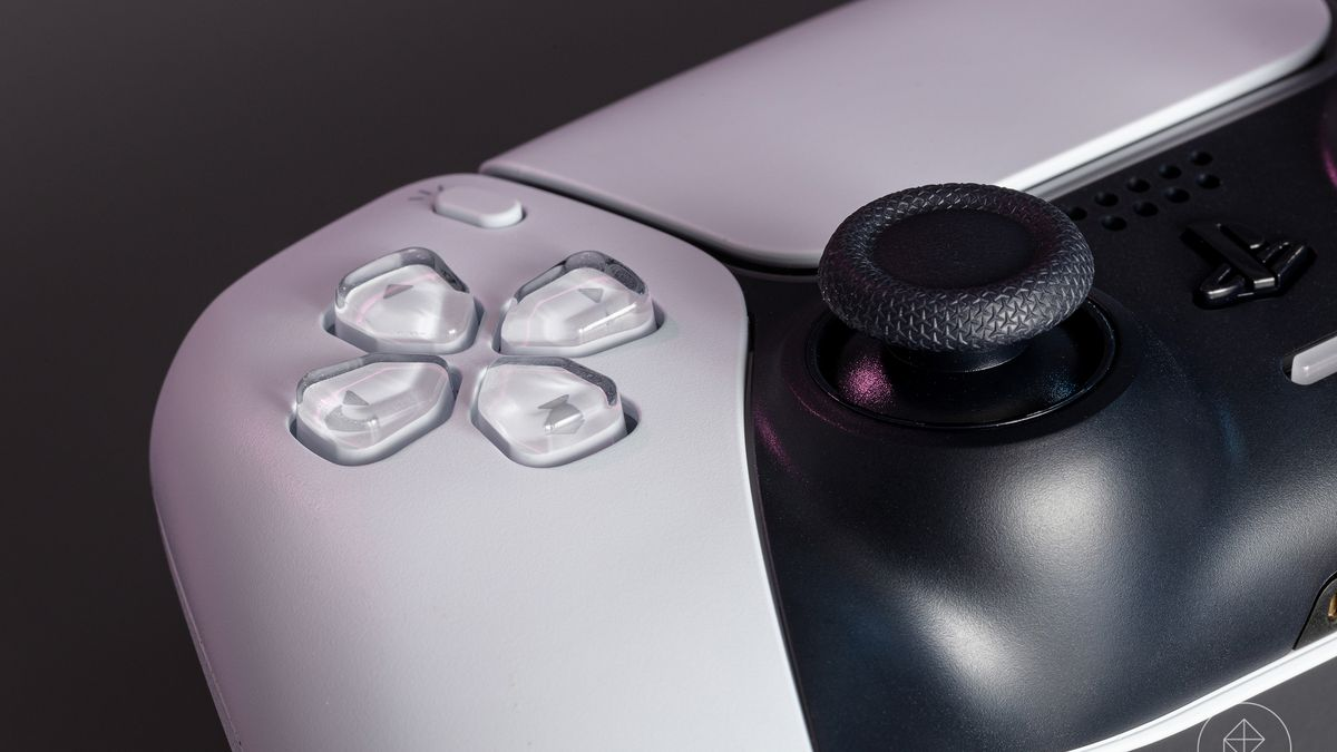 a close-up of the D-pad and left analog stick of the PS5's DualSense controller