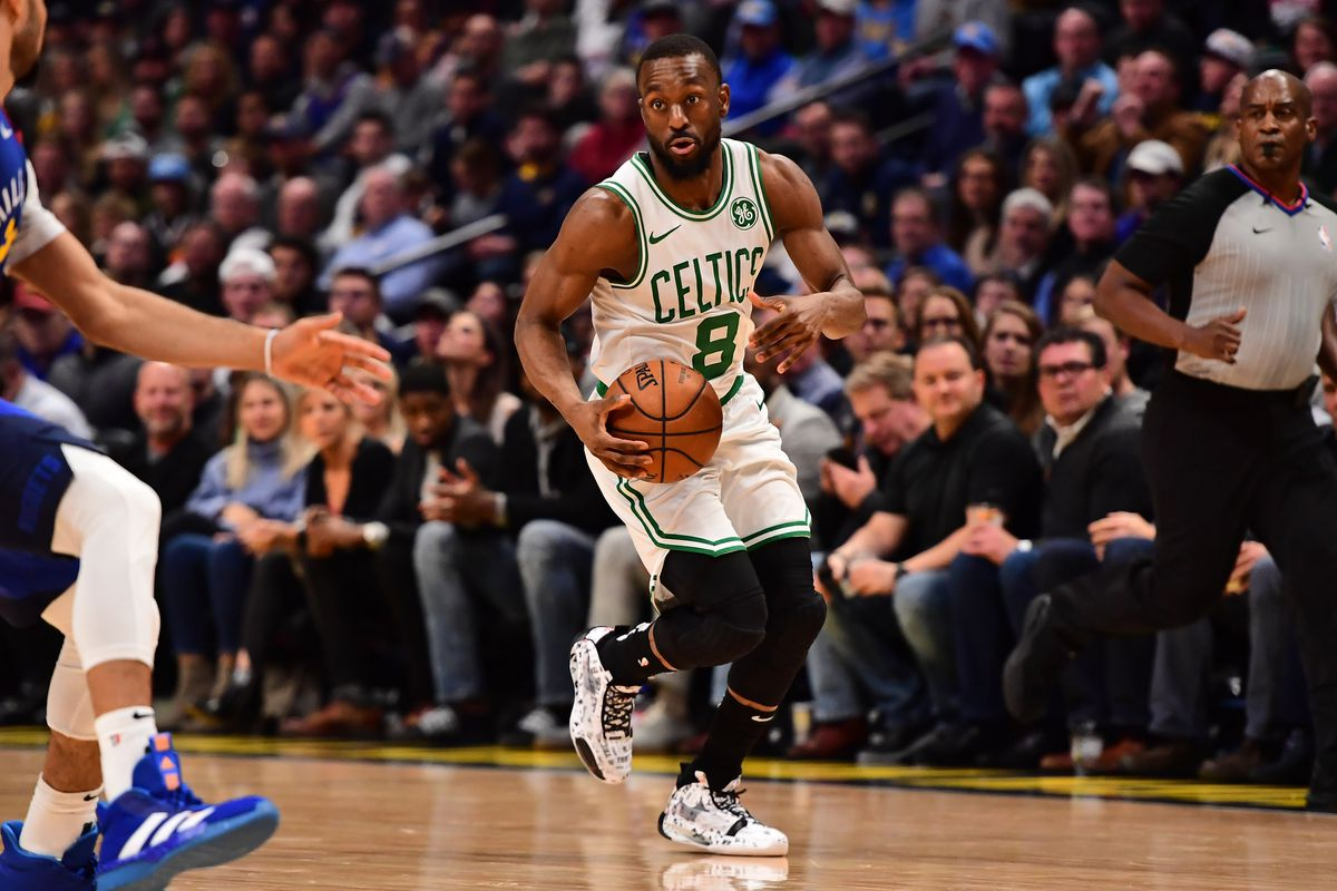 Boston Celtics guard Kemba Walker drives to the basket in the second quarter against the Denver Nuggets at the Pepsi Center.