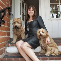Hamilton outside the Westwood studio with her mascots, Archie and Beatrice.