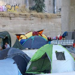 Refugees camp under an overpass near the Port of Piraeus in Athens, Greece, in July 2016.