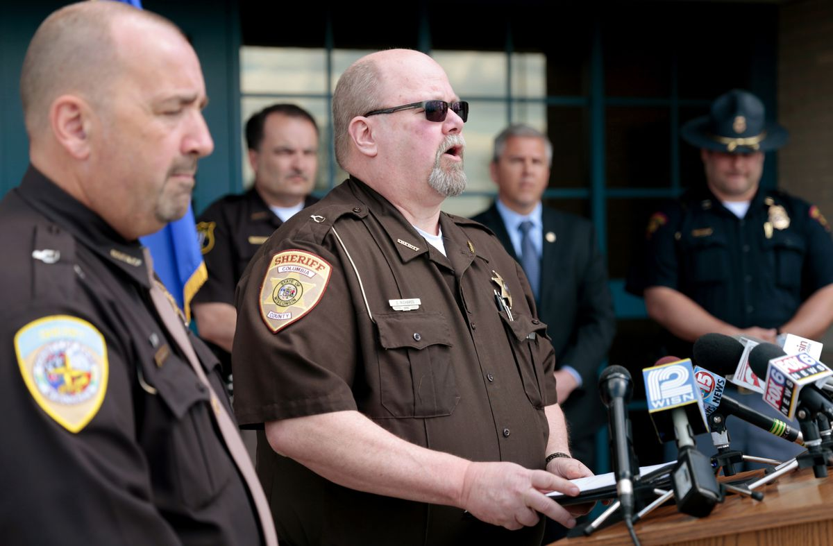 Columbia County Sheriff Dennis Richards speaks during a press conference at the Wisconsin State Patrol's DeForest Post on Monday. On Sunday, a suspect in a suburban Milwaukee homicide was shot and wounded by police near DeForest after also firing on a car