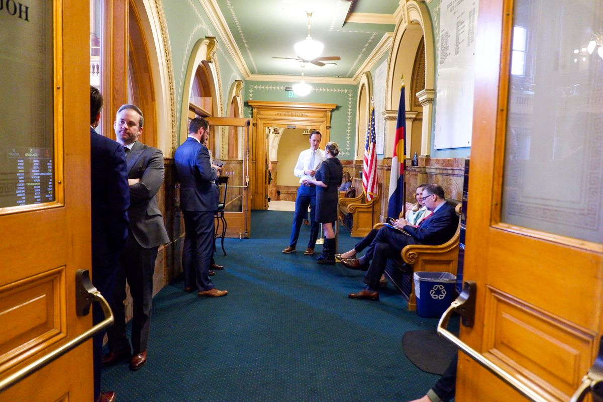 A half dozen lobbyists lean on walls and sit on benches in the lobby of the Colorado House of Representatives.