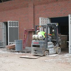 2:37 p.m. More bricks being moved inside, along Sheffield -