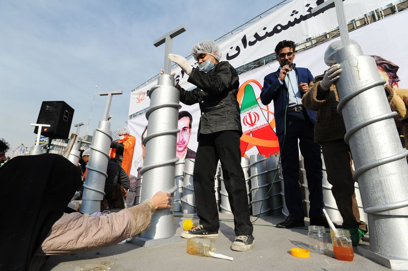 """Iranian children build model centrifuges out of styrofoam and glue in a competition beneath a banner reading """"Nuclear scientists of the next generation"""" at a mass rally to mark the 35th anniversary of the 1979 Islamic revolution on February 11, 2014 in Te"""