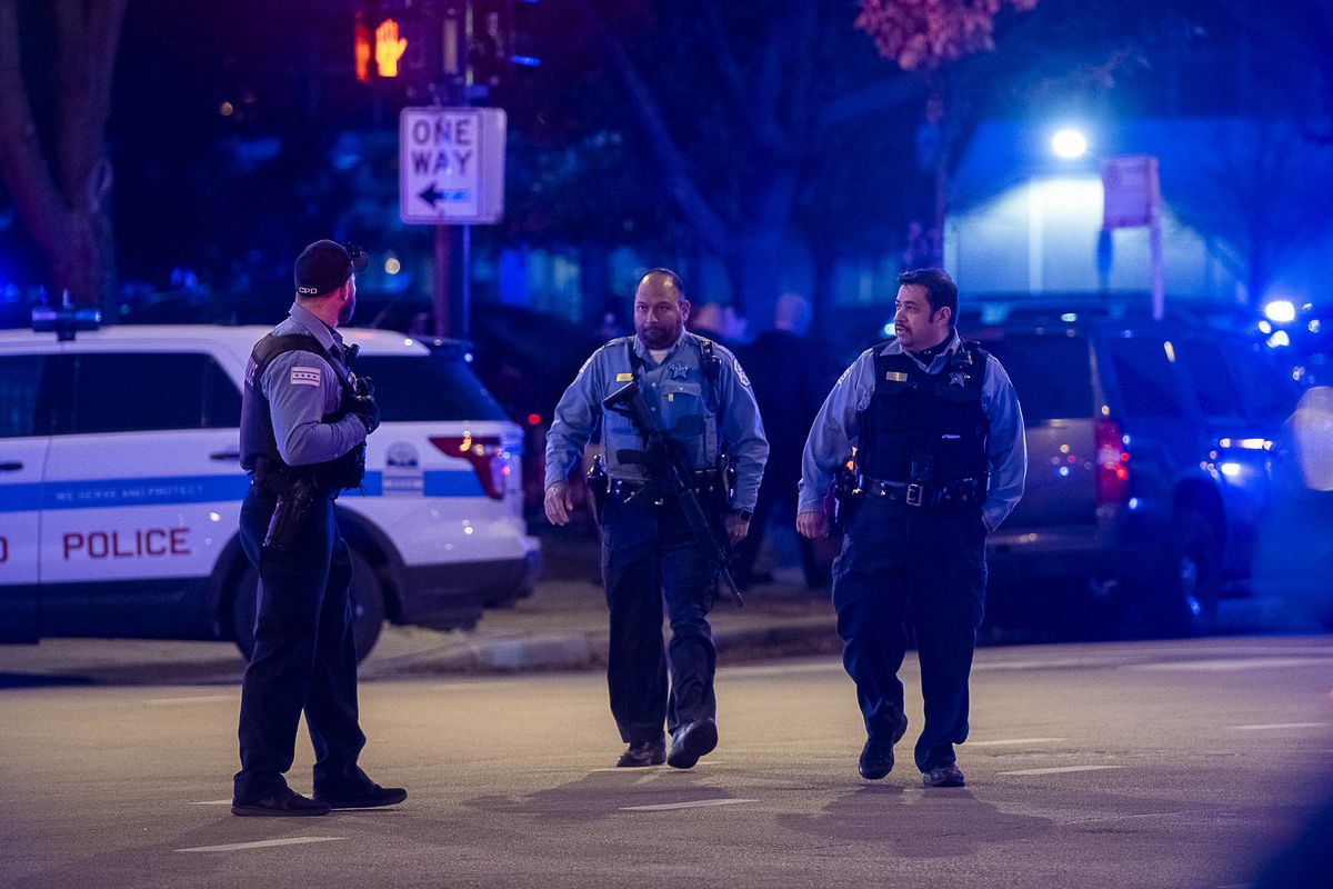 Police secure the area around Mercy Hospital where multiple people were shot, including a Chicago police officer on Monday.   Tyler LaRiviere/Sun-Times