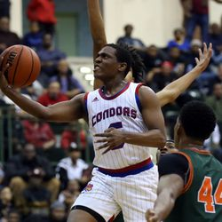 Curie's Trevon Hamilton (5) scores against Morgan Park in their 65-60 CPS Championship game at Chicago State University in Chicago, Sunday, February 17, 2019. | Kevin Tanaka/For the Sun Times