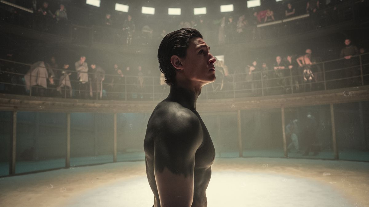 A man covered in black body paint stands in a circular arena in Netflix's Tribes of Europa