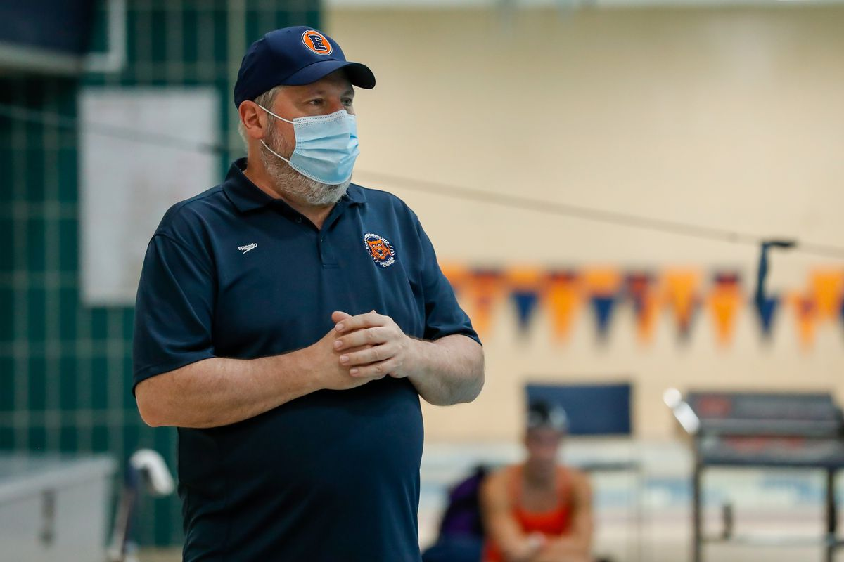 Evanston coach Kevin Auger gives instruction during swim practice in August.