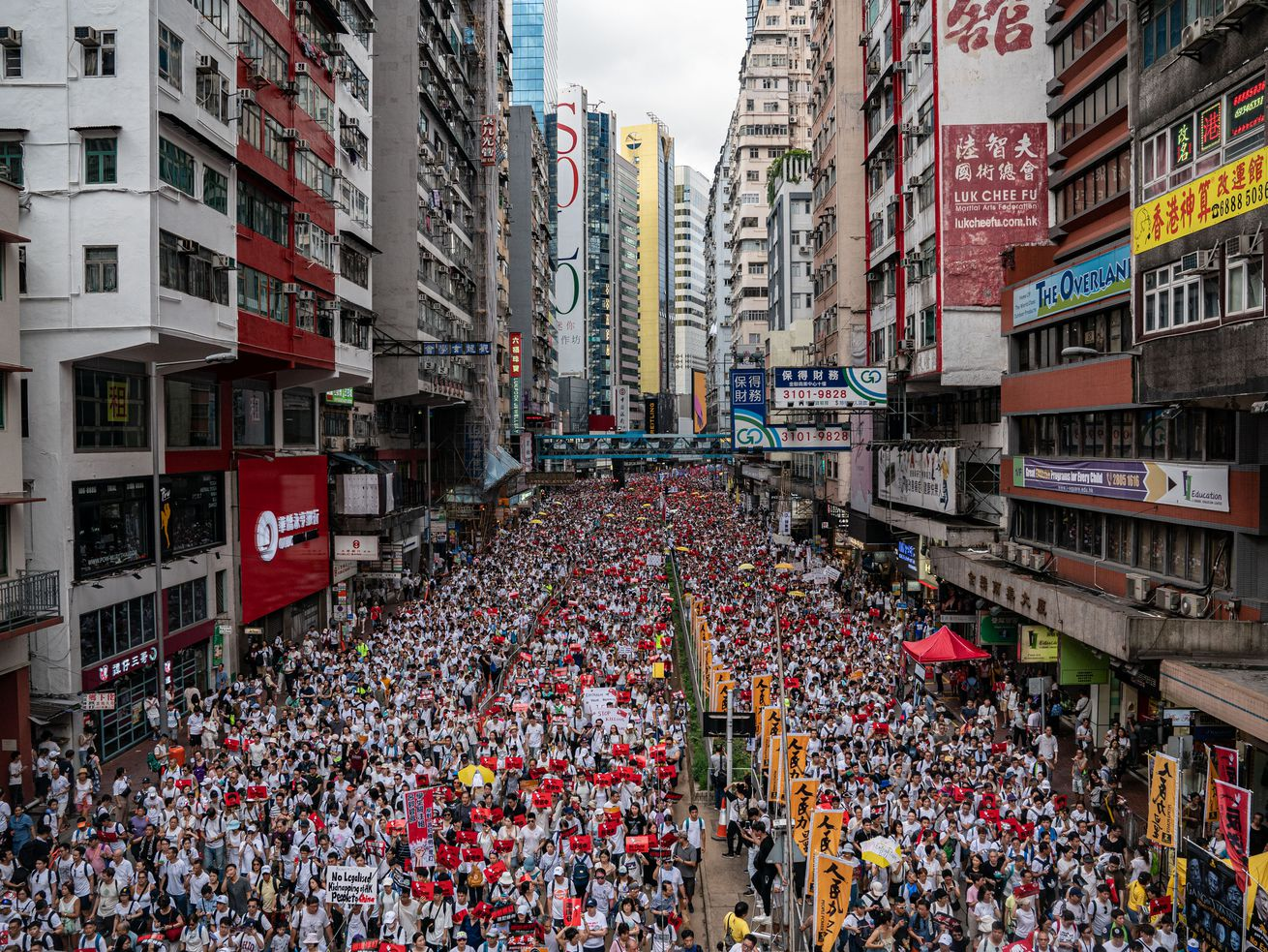 Protesters march against a new extradition law proposal on June 9, 2019 in Hong Kong.
