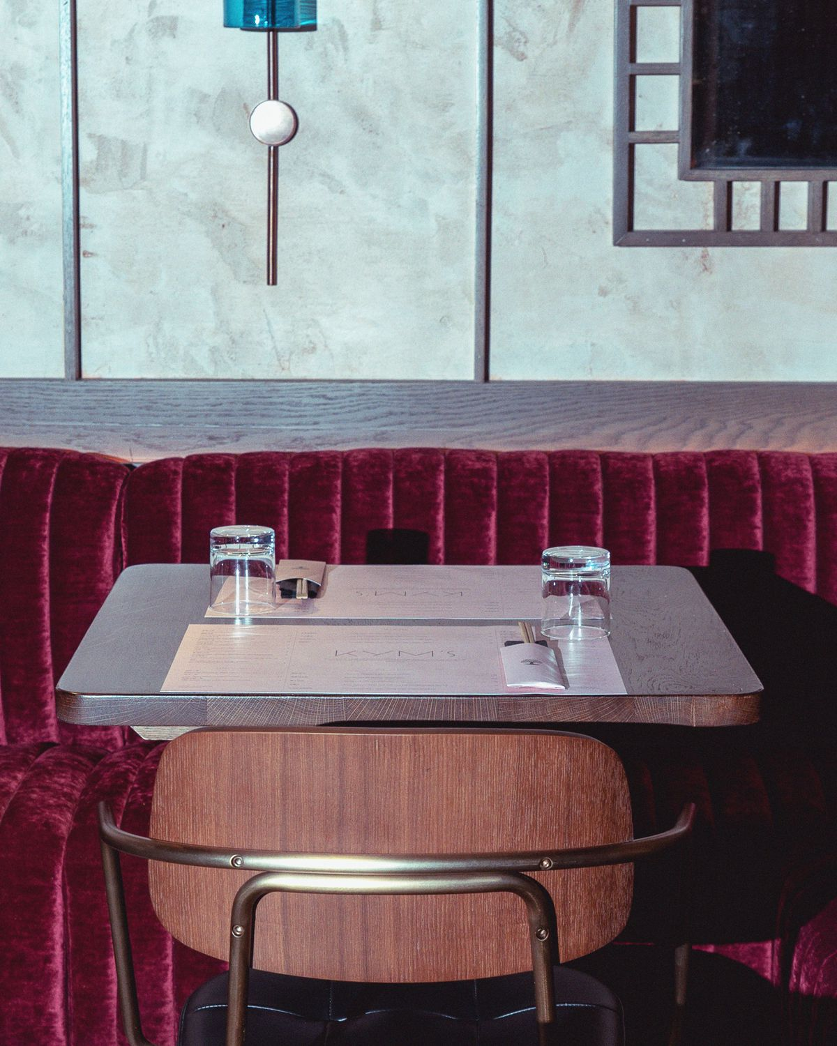 Table-setting with velvet banquettes and chopsticks at Kym's in the Bloomberg Arcade restaurant development, London - the follow-up to Michelin-starred dim sum restaurant A. Wong in Victoria