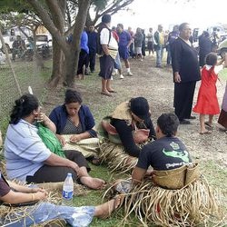Concerned family and members of the community gather near the ports of the Tongan capital, Nuku'alofa Thursday waiting for news after a ferry carrying 49 passengers and 30 crew sank at around midnight Wednesday.