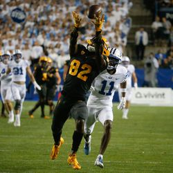 Arizona State wide receiver Andre Johnson (82) receives a pass as Brigham Young defensive back Isaiah Herron (11) watches during an NCAA college football game at LaVell Edwards Stadium in Provo on Saturday, Sept. 18, 2021.