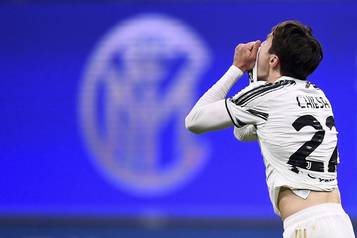 Federico Chiesa of Juventus FC looks dejected in front of a...