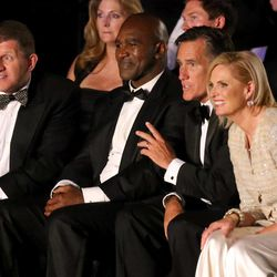 Five-time heavyweight champion Evander Holyfield, former Massachusetts Gov. Mitt Romney and his wife Ann Romney watch fights before Holyfield and Romney's fight at Charity Vision Fight Night at The Rail Event Center in Salt Lake City on Friday, May 15, 2015.