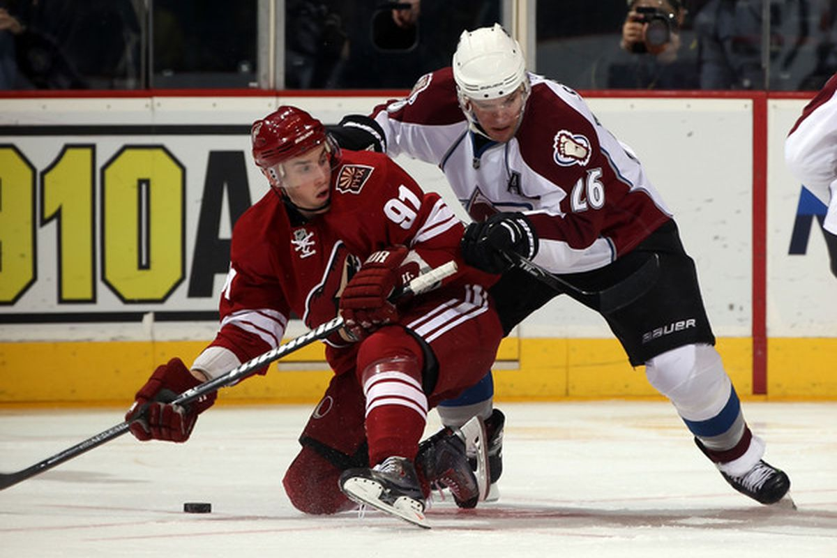 GLENDALE AZ - FEBRUARY 07: Paul Stastny #26 of the Colorado Avalanche hits Kyle Turris #91 of the Phoenix Coyotes at the Jobing.com Arena on February 7 2011 in Glendale Arizona.  (Photo by Bruce Bennett/Getty Images)