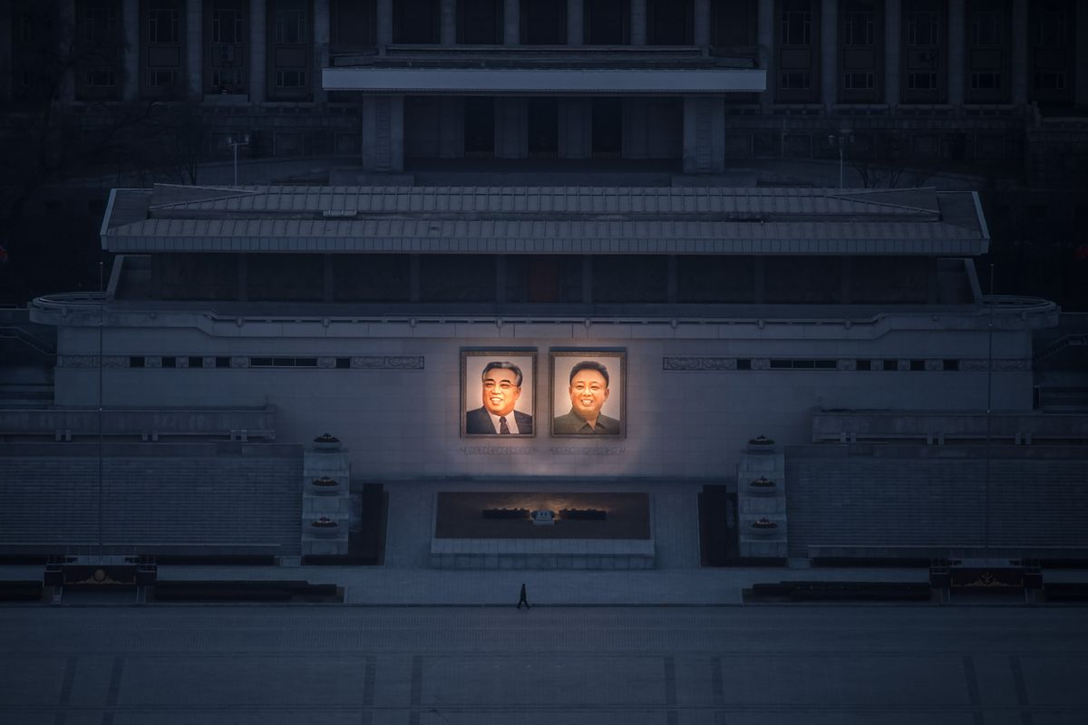 Portraits of late North Korean leaders Kim Il-Sung and Kim Jong-Il in Pyongyang, as seen from the landmark Juche tower