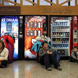 Travelers wait at Salt Lake City International Airport as flights were delayed or canceled during a snowstorm, Thursday, Dec. 19, 2013.