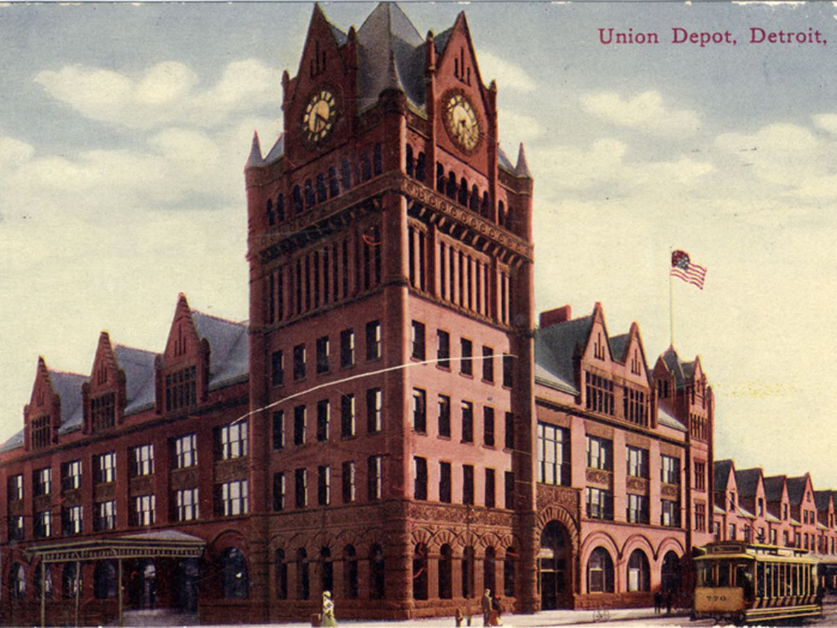 The exterior of Fort Street Union Depot in Detroit. The facade is red brick with a clock tower.