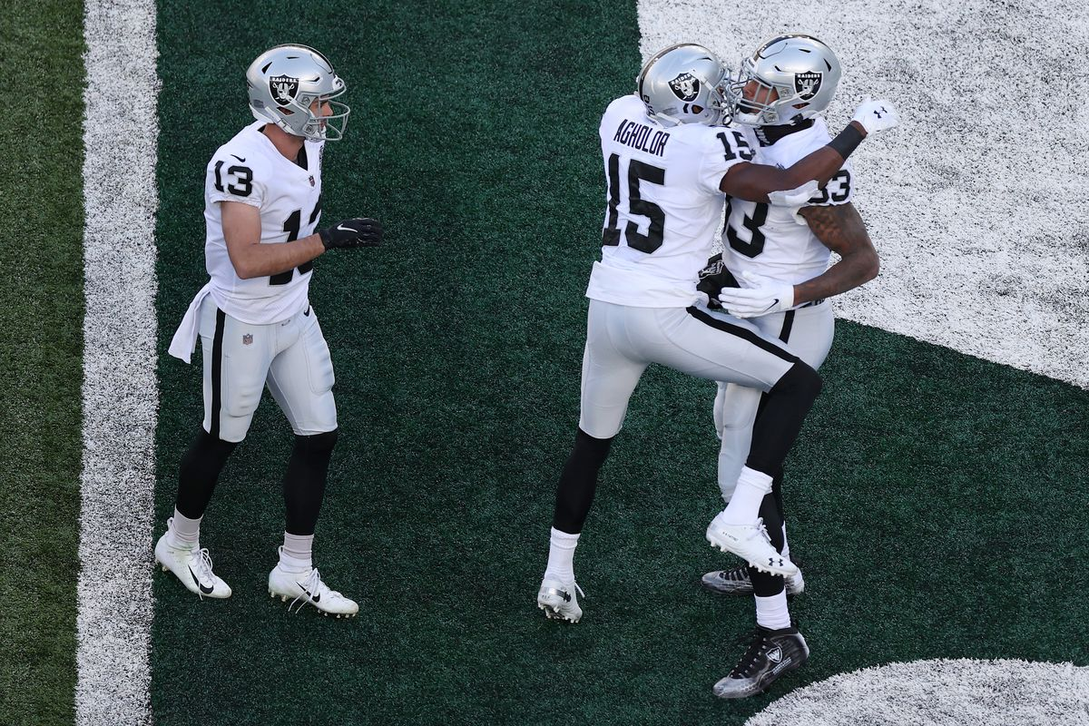 Darren Waller #83, Nelson Agholor #15, and Hunter Renfrow #13 of the Las Vegas Raiders celebrate Waller's touchdown during the first half against the New York Jets at MetLife Stadium on December 06, 2020 in East Rutherford, New Jersey.